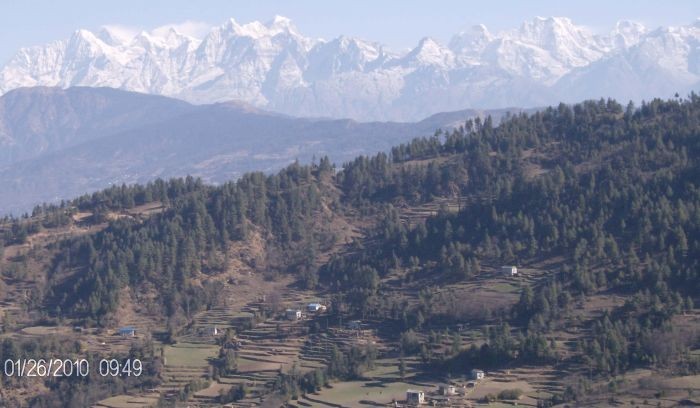 Typical sherpa village with mountain views in Background