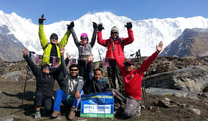 Happy Malaysian trekkers at Annapurna base camp