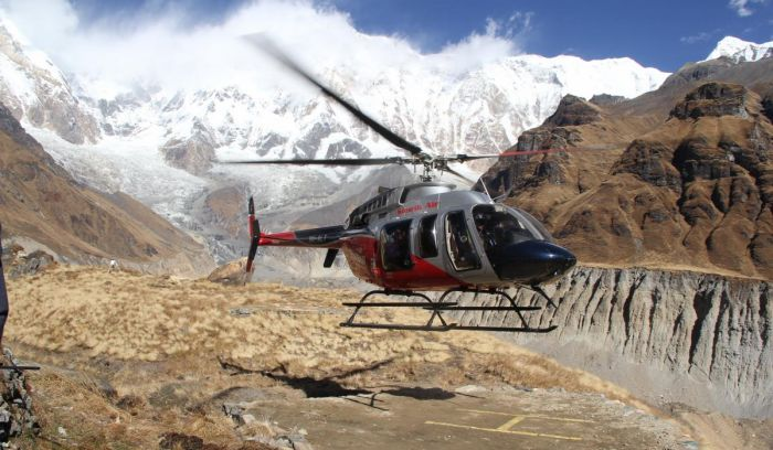 Helicopter landing at Annapurna base camp 4130m